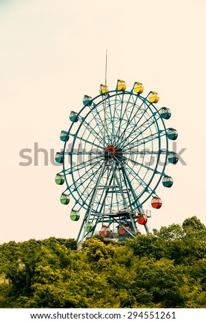 Amusement park ferris wheel in the sky
