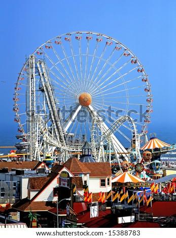 Amusement park rides against blue sky - stock photo