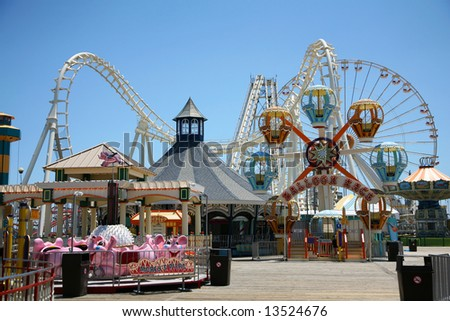 amusement park rides with blue background - stock photo