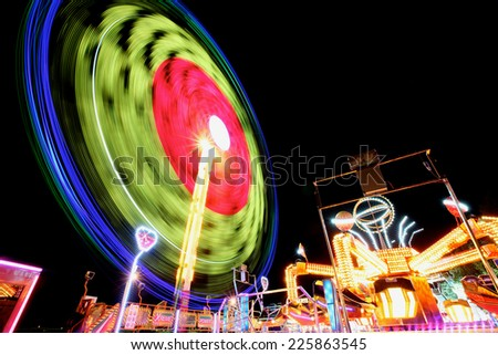 Amusement park shot with a long exposure at night - stock photo