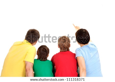 Amusing family in bright T-shirts on a white background - stock photo
