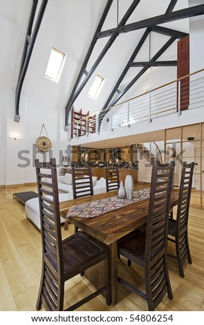amzing conversion apartment with high ceiling and exposed beam construction - stock photo