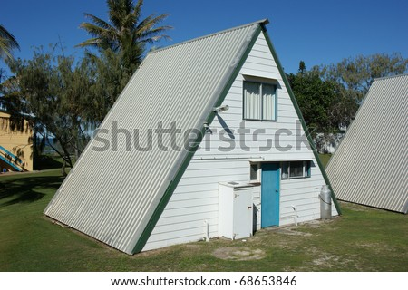 An A framed, 2 storey house - stock photo