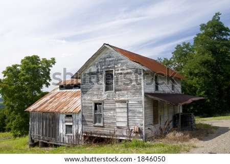 An abandoned house along a road near Seneca Lake in the New York State Wine Region. - stock photo