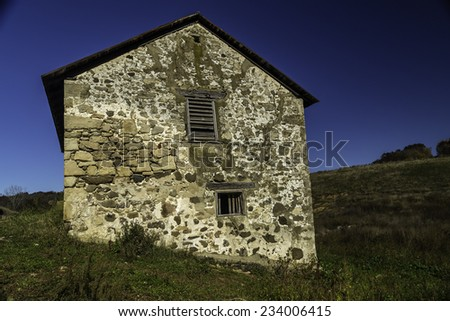 An abandoned house falling into ruin - stock photo