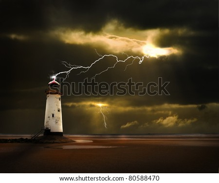 an abandoned lighthouse on the welsh coast is struck by a lightning bolt during an electrical storm at sea - stock photo
