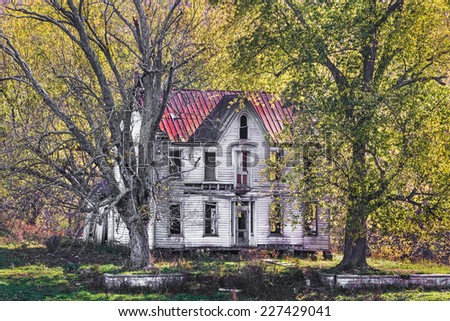 An abandoned old house in rural Indiana hints of better days gone by. - stock photo