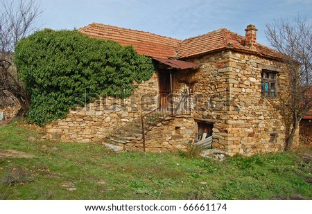 An abandoned old house in the village - stock photo