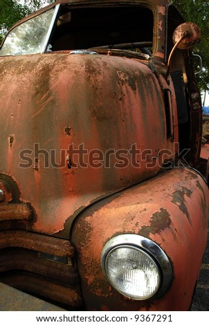 An abandoned old rusty truck - stock photo