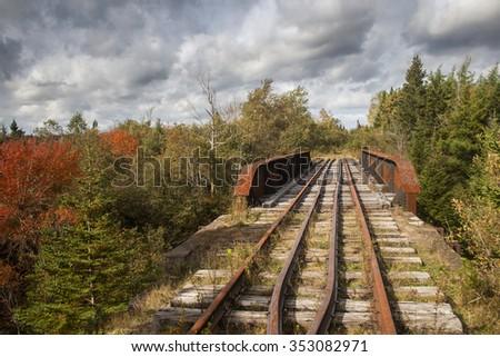 An abandoned railway bridge in autumn. Nova Scotia, Canada. - stock photo