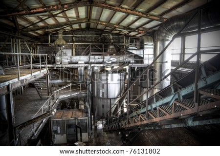 An abandoned sugar factory at it's best, rusted steel, dusty stairs and gigantic halls complete this great scenery. - stock photo