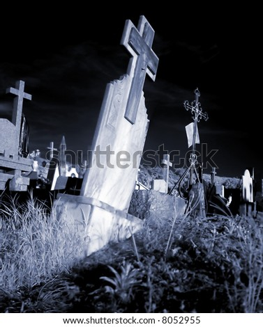An abandoned tombstone in a country cemetery. - stock photo