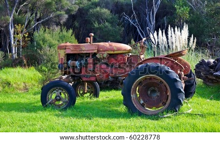 An abandoned tractor on North Island, New Zealand. - stock photo