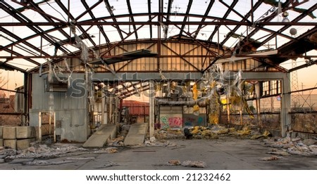 An Abandoned Warehouse Building with an Open Roof