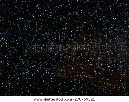 an abstract background resembles starry Sky. The image is processed electronically selective lighting and color. - stock photo