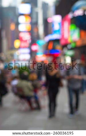 An abstract blur of a couple in Times Square in New York City. - stock photo
