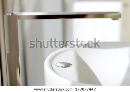 An abstract detail of a contemporary wash-hand basin and faucet - stock photo