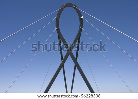 An abstract detail of a futuristic metal structure over a blue sky (abstract wallpaper). Aveiro, Portugal - stock photo
