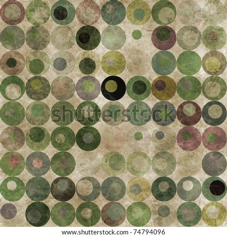 An abstract grungy image of circles with nested circles in green tones - stock photo