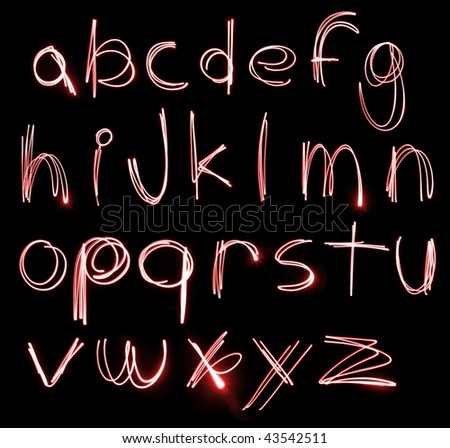 An abstract illustration of the alphabet created with light. - stock photo