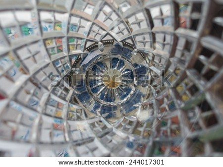 An abstract macro shot looking down into a cut glass vase. - stock photo
