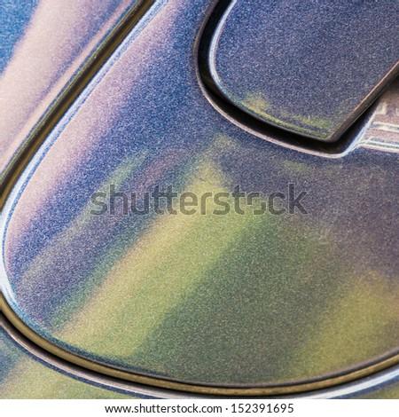 An abstract macro shot of a car door handle. - stock photo