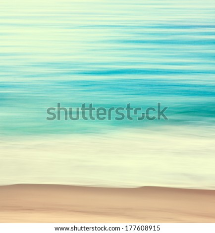 An abstract ocean seascape with blurred panning motion.  Image displays a retro look with cross-processed colors. - stock photo