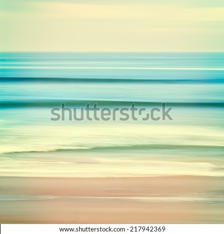 An abstract ocean seascape with blurred panning motion.  Image displays cross-processed colors. - stock photo
