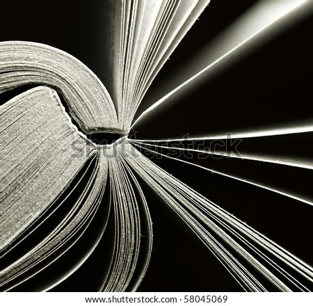 An abstract of a well read novel with glowing pages. - stock photo