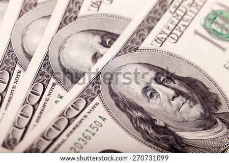 An Abstract of One Hundred Dollar Bills with Narrow Depth of Field closeup.