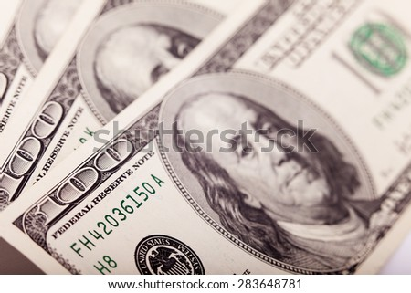 An Abstract of One Hundred Dollar Bills with Narrow Depth of Field closeup. Business concept. Selective focus, blurred background - stock photo