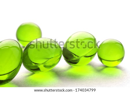 An abstract picture of vitamins pills in green color - stock photo