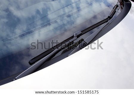 An abstract section of the front end of a silver vehicle and its front windscreen bonnet and wipers - stock photo