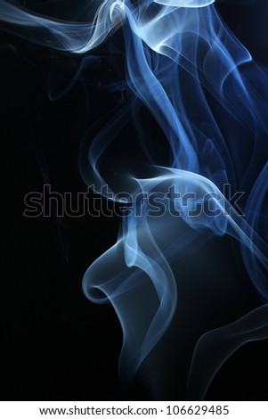 an abstract smoke picture in front of a black background - stock photo