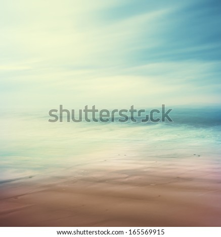 An abstract, time-exposure seascape with panning movement.  Image displays a retro, vintage look with cross-processed colors. - stock photo