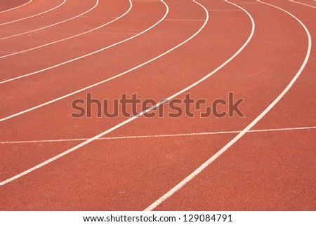 An abstract view of a red athletics track