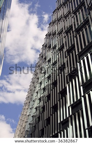 an abstract view of an office block against a blue sky