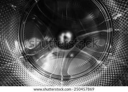 An abstract view on the inside of a revolving washing machine - stock photo