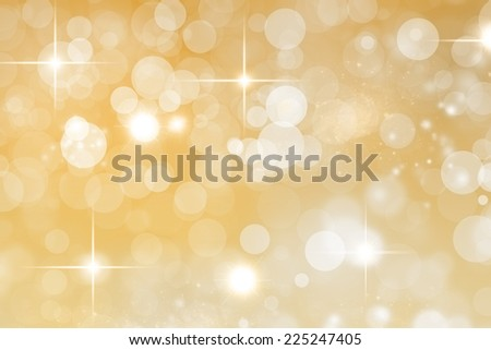 An abstract yuletide background with bright stars and defocused lights effect - stock photo