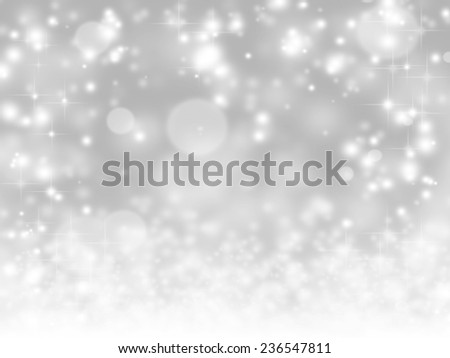 An abstract yuletide background with bright stars and defocused lights effect