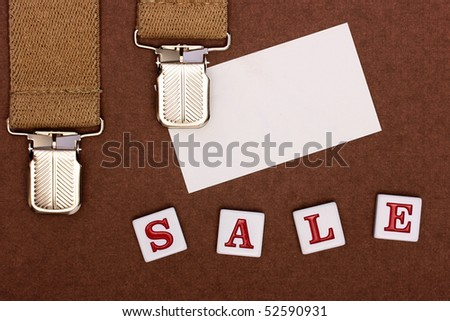 An accessory from man's clothes, a place for business of a card and an inscription made of plastic letters Sale.
