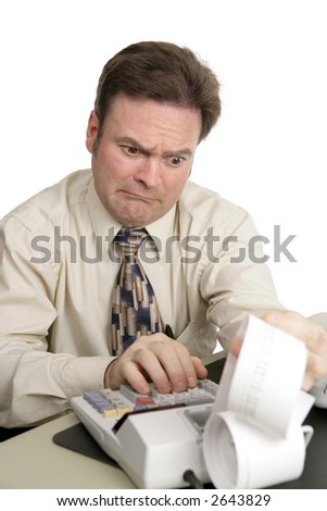 An accountant going over figures and very upset by the result.  Isolated on white. - stock photo