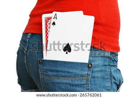 An ace and a hidden playing cards in a rear pocket of a jeans - stock photo