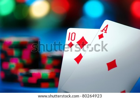 An Ace and a Ten card make Blackjack on a blue background - stock photo