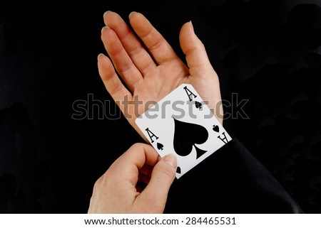 an ace up your sleeve on black background showing