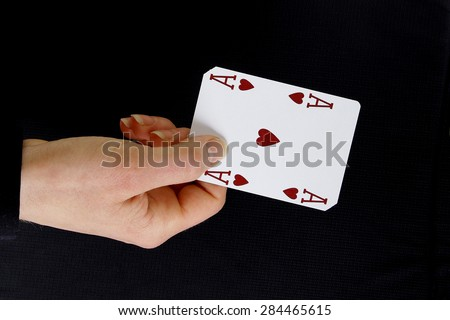 an ace up your sleeve on black background showing hearts