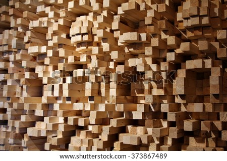 An acoustic diffuser made out of wooden tinder blocks mounted on a wall in a music industry recording studio. - stock photo