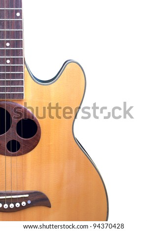 An acoustic guitar - stock photo