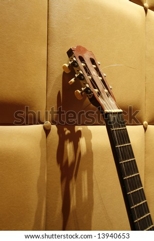 an acoustic guitar with a simple background at night - stock photo