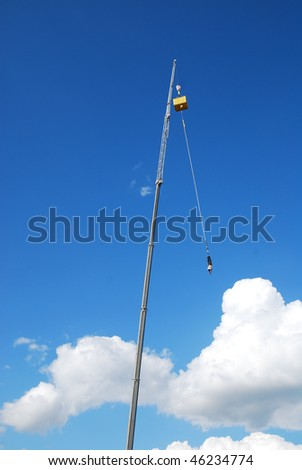 an action sports thrill seeker after jumping from a bungee platform - stock photo